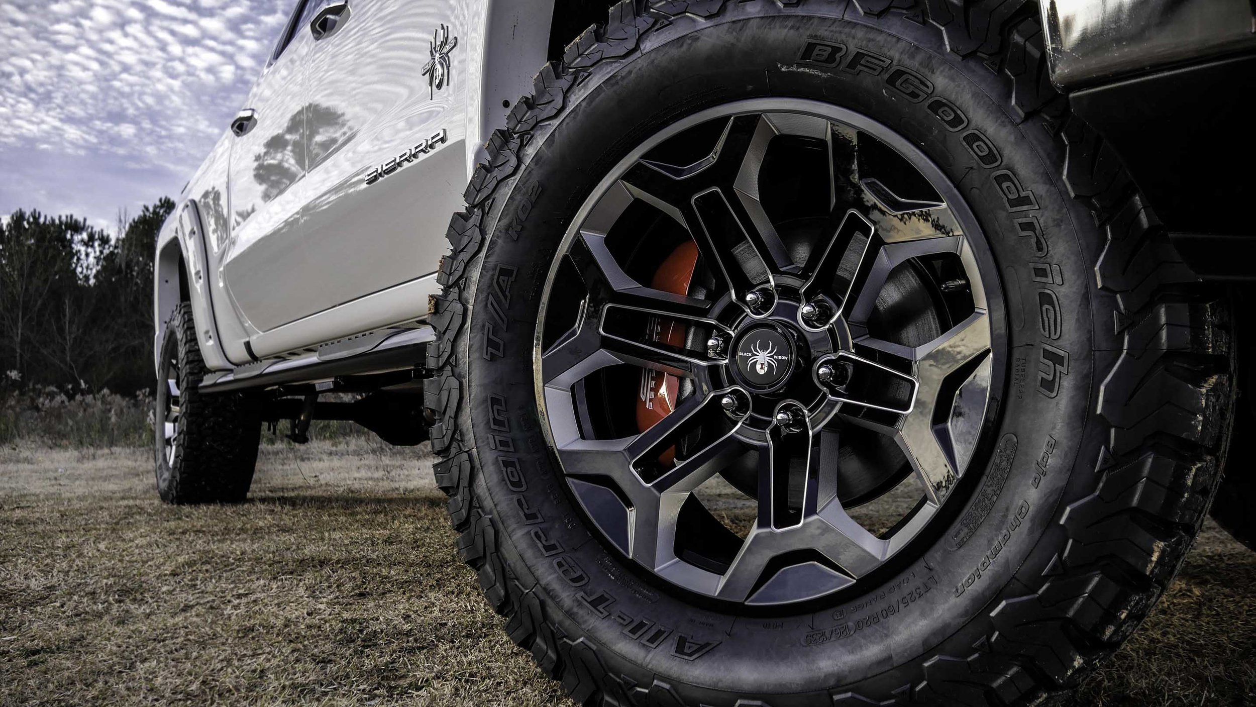 2019 GMC Sierra Black Widow Wheel Close Small.jpg
