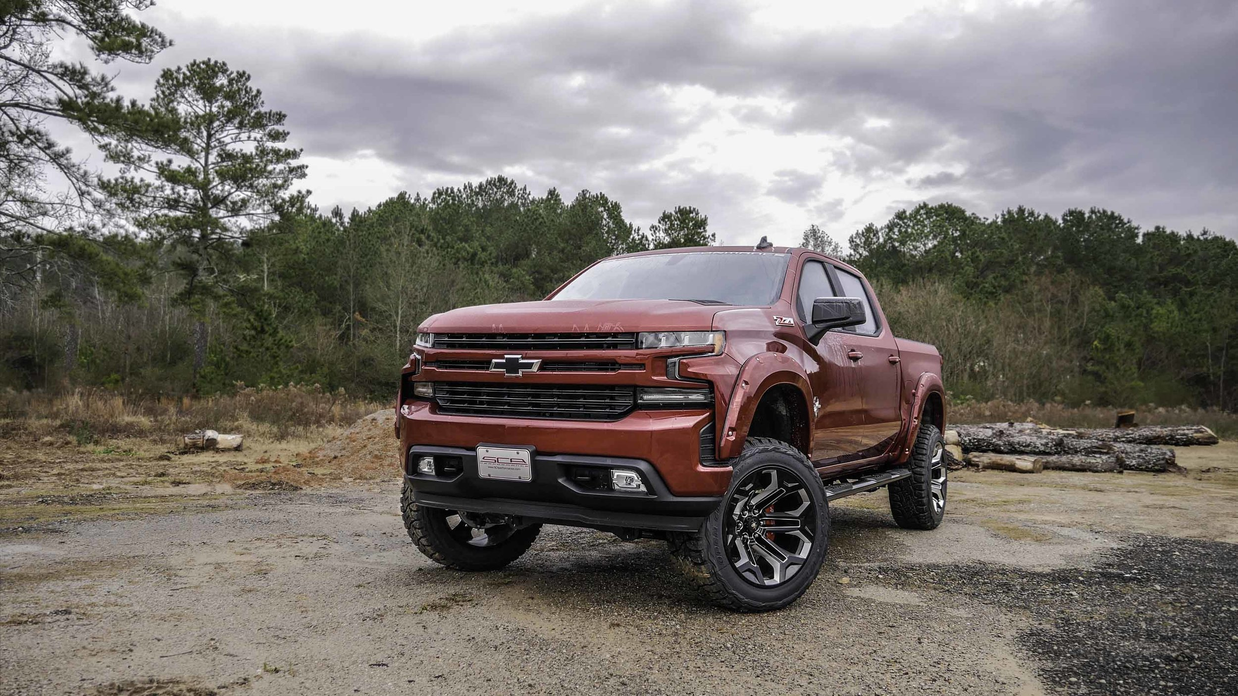2019 Chevy Black Widow Cajun Red with 22s Small.jpg