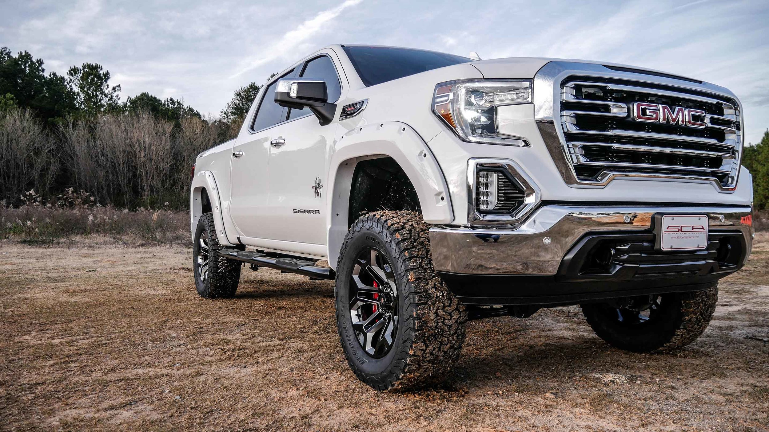 2019 GMC Sierra Black Widow White Side Qtr Close.jpg