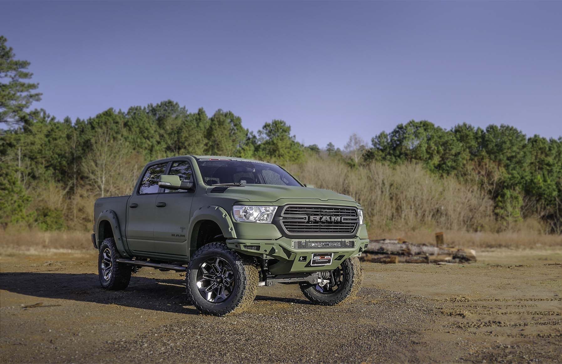 2019 RAM AFBW OD Green with Color Matched Bumper Blurred Background.jpg