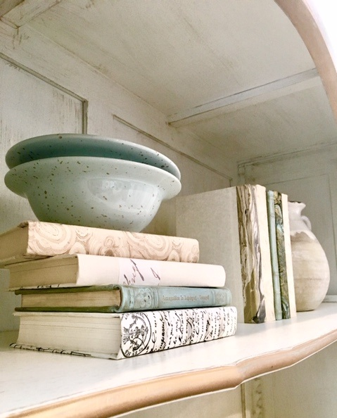 1. Horizontal & Vertical Books - Stack your books horizontally or vertically. This will add visual depths to your bookshelf and allow you to accent with a variety of pieces. Have 3-6 books per stack and accent with small bowls, vases, and pictures.