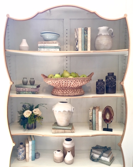 7. Keep it simple - Decorating your home should be FUN! Don't feel like you have to fill all of the space on your shelves. Accent with items that you love, and your home will feel comfortable and not cluttered.