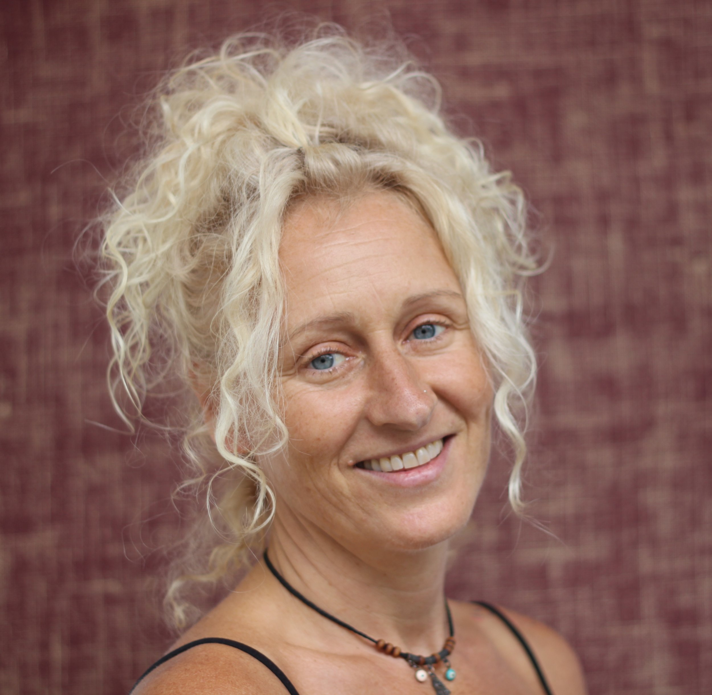 Ellie Steel    Saturday's 12.00pm - 13.15pm - Dharma Yoga    Fridays 13.00-14.30pm - Level 3 Practice     Ellie was first introduced to yoga whilst travelling in India in 1996 during which time she developed a deep self- practice and love of yoga. In 2006 she officially began to teach yoga which for her was a natural progression from her extensive background in alternative therapies and sports therapy.  Ellie is passionate about sharing the knowledge she accumulated over the past 20 years of study, practice and teaching and her teaching style reflects her knowledge of anatomy and the physical body as well as the spiritual aspects of yoga.  Ellie first practiced and studied Dharma Yoga with Sri Dharma Mittra in 2006 and this was the turning point in her life and yoga practice. After training in Ashtanga and Vinyasa yoga, Ellie then took her studies further and undertook an advanced 500hr Dharma Yoga training under the guidance of her Guru Sri Dharma at his New York studio.  Ellie continues to visit her guru in New York when she can and in London she practices regularly with her mentor Mark Kan.  She believes that yoga is a constant journey of learning; Ellie has teaching qualifications in Rocket yoga, Vinyasa flow and Ashtanga as well as a 500hr advanced teaching qualification in Dharma yoga, she is also trained in sports therapy.    Ellie's classes start with a calming breathing practice followed by a short grounding meditation to prepare body and mind for the physical practice.  She takes the key poses of the Dharma asana......twists, balances, inversions and backbends and combines them to create a dynamic and fun flowing practice. She always ensures there are plenty of variations for all levels of students and you are always encouraged to practice mindfully and without ego, listening to your body and allowing body and breath to flow together as one making your practice no matter how dynamic into your moving meditation.