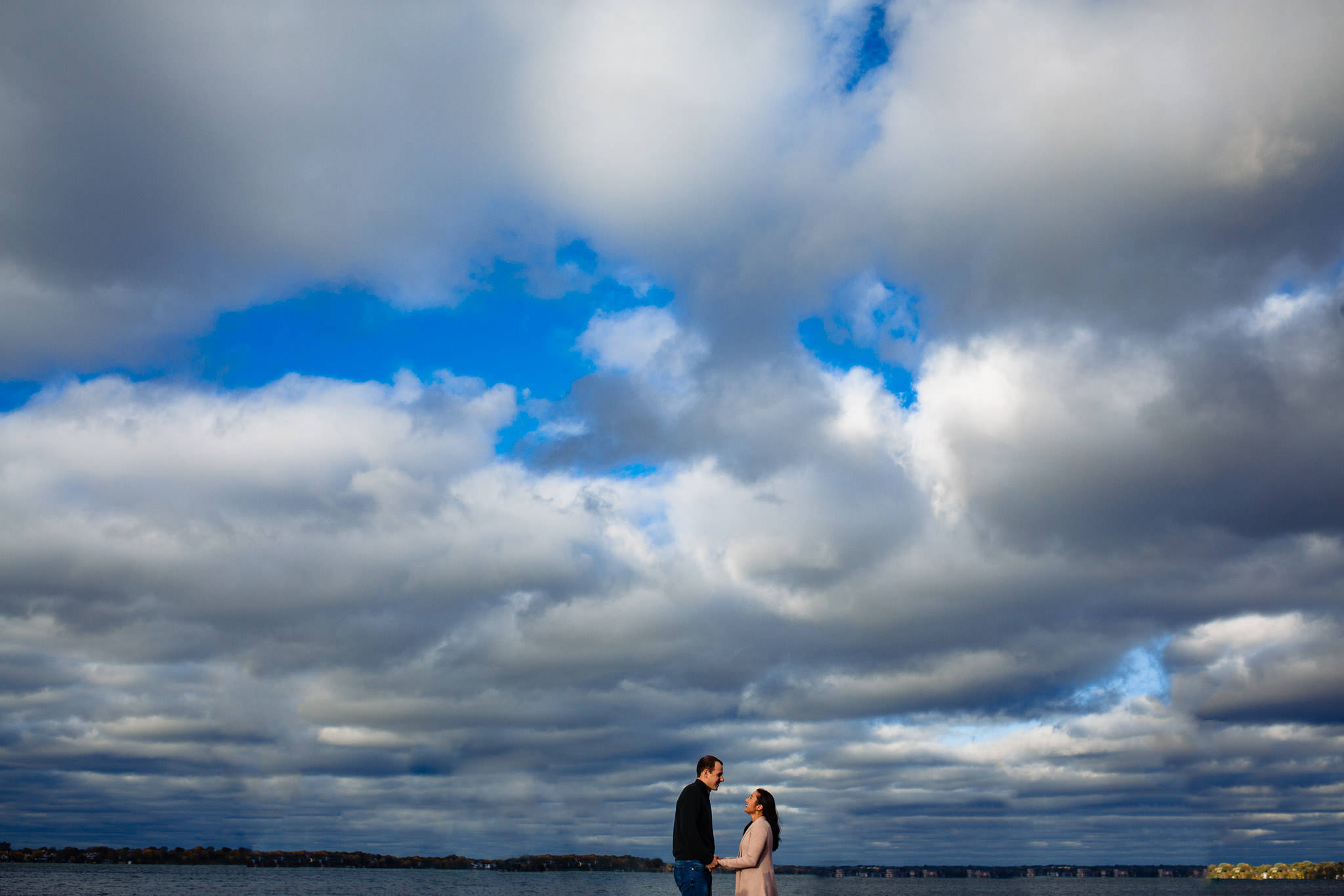 Madison engagement session with blue sky and clouds.