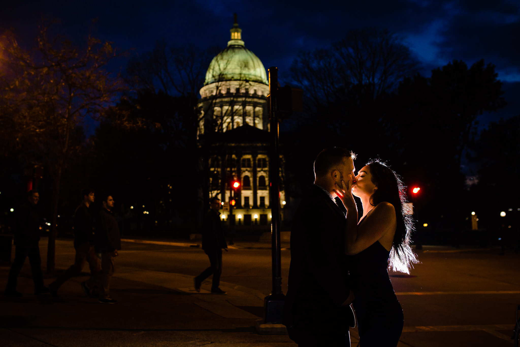 A romantic embrace in front of the Wisconsin State Capitol.