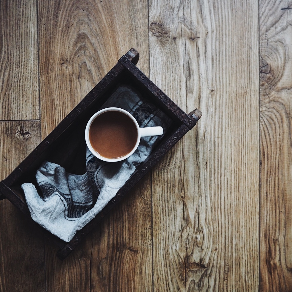 Cup of tea in a tray on a wooden table.jpg