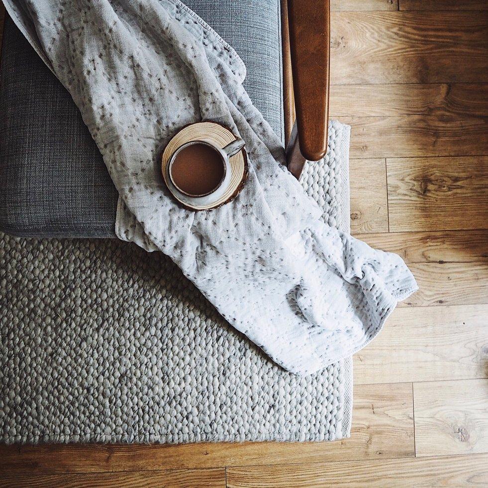 Cup of tea on a blanket on an armchair.jpg