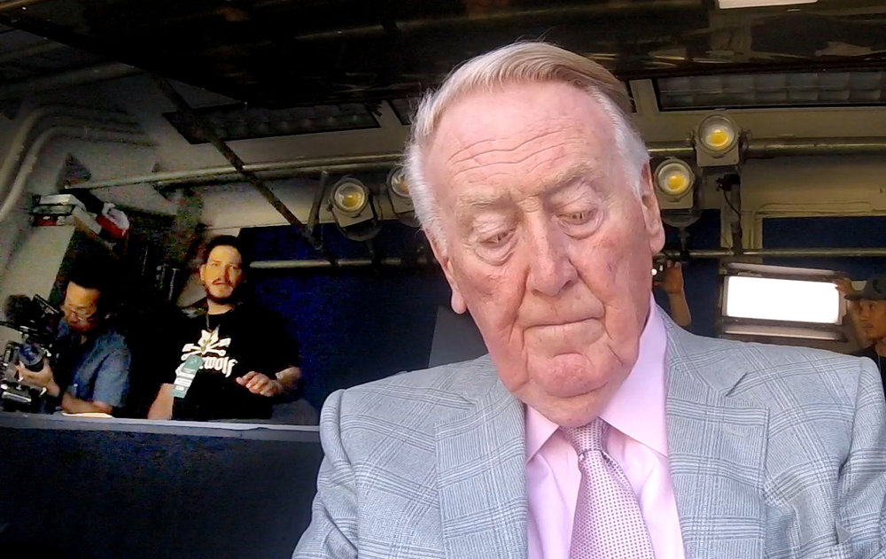 "Vin Scully delivering ""they always do"" referring to the great unpredictable moments in baseball."