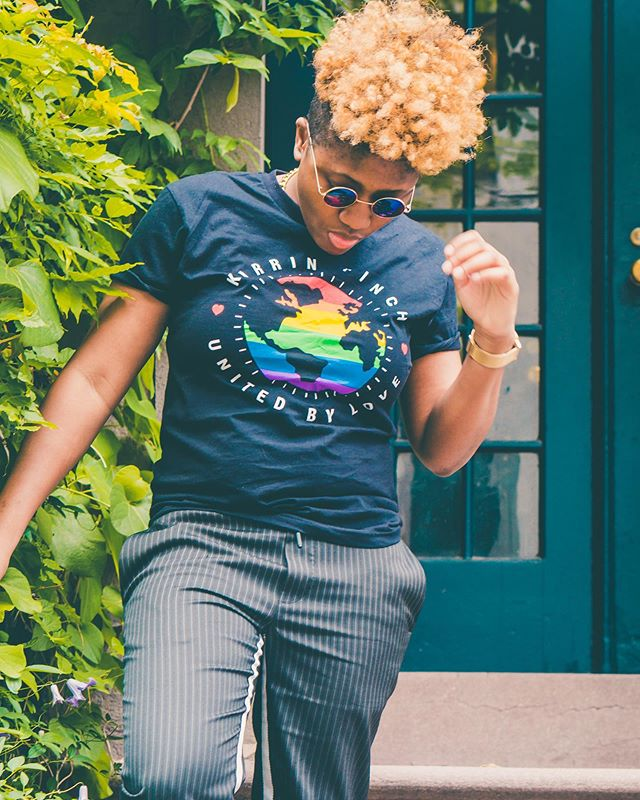 We're supporting queer brands all day everyday, especially during PRIDE MONTH! Head to the link in my bio and add this super cute @kirrinfinch pride tee to your wardrobe! A portion of the proceeds will go to the Trevor Project in support of LGBTQ youth! 📸@umbra_et_lux
