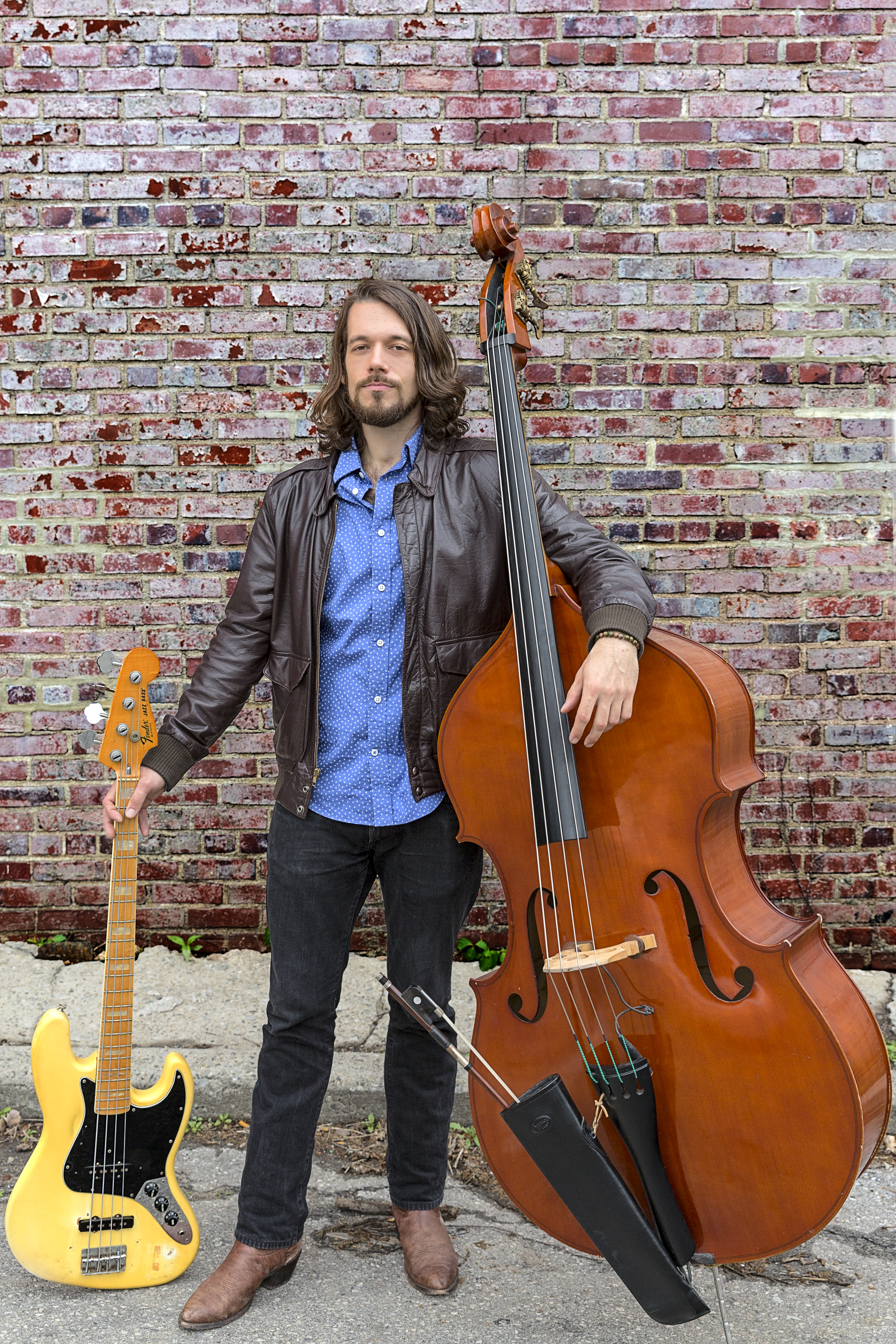 Seth Barden plays upright and electric bass