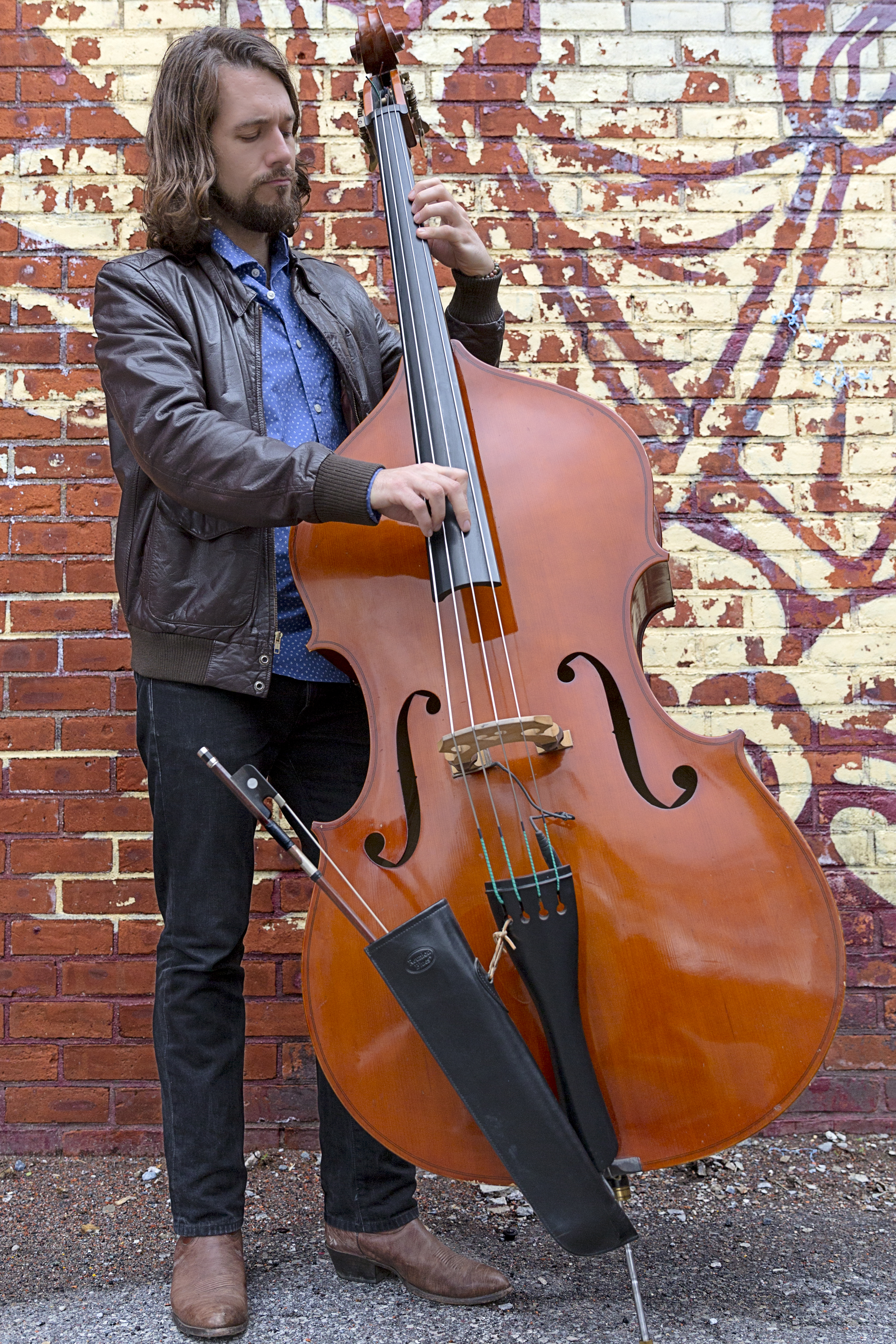 Seth Barden playing upright bass. Photo by Angelys Ocana.