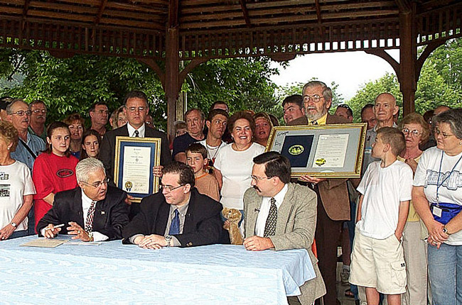 2003 - The famous fighting families, the Hatfield's and McCoys, make peace. Ending a century long feud over land, and livestock ownership.