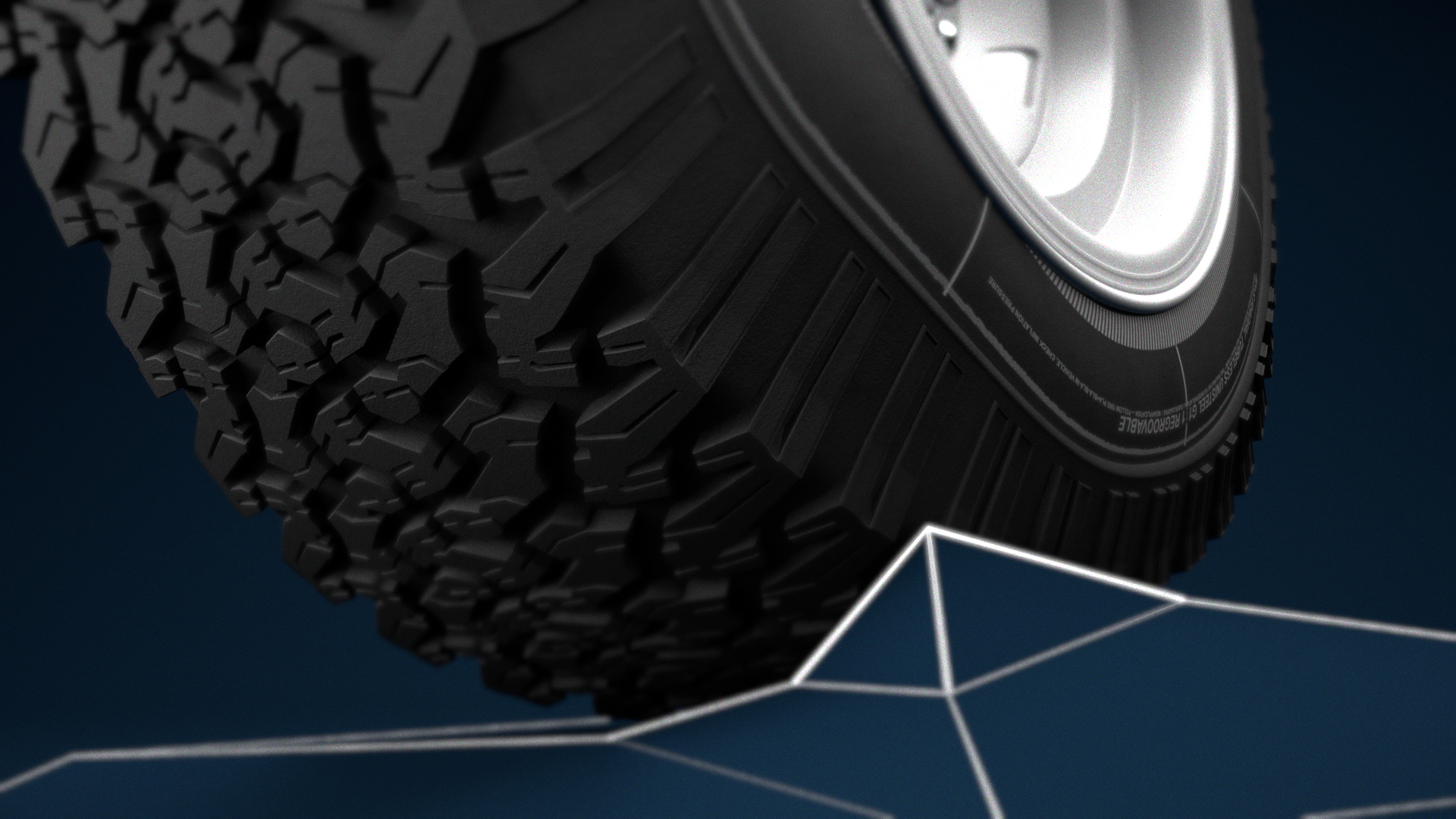 Truck tire going over our stylized version of rough terrain.