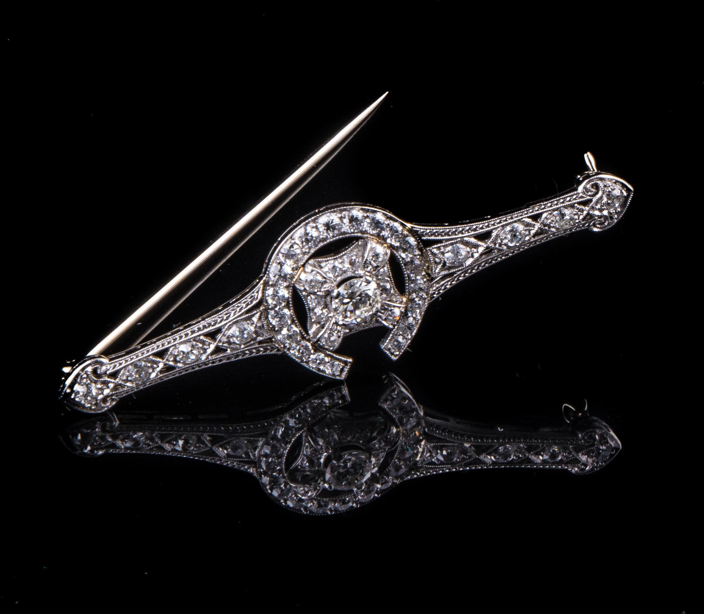 Art Deco horseshoe design platinum brooch with diamonds
