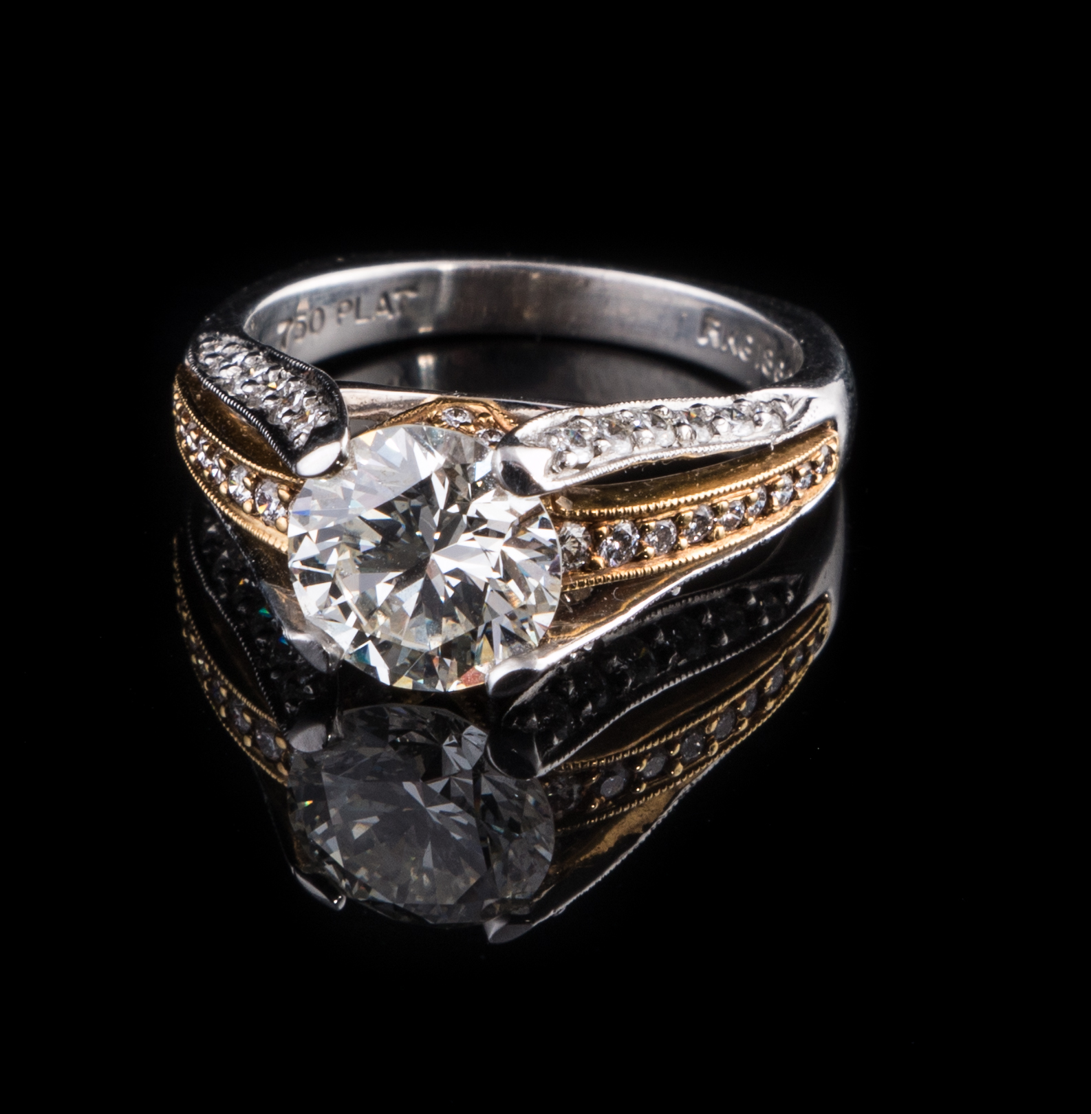 18kt yellow gold and platinum ring with 2 carat center Diamond and .50 carat accent Diamonds.jpg