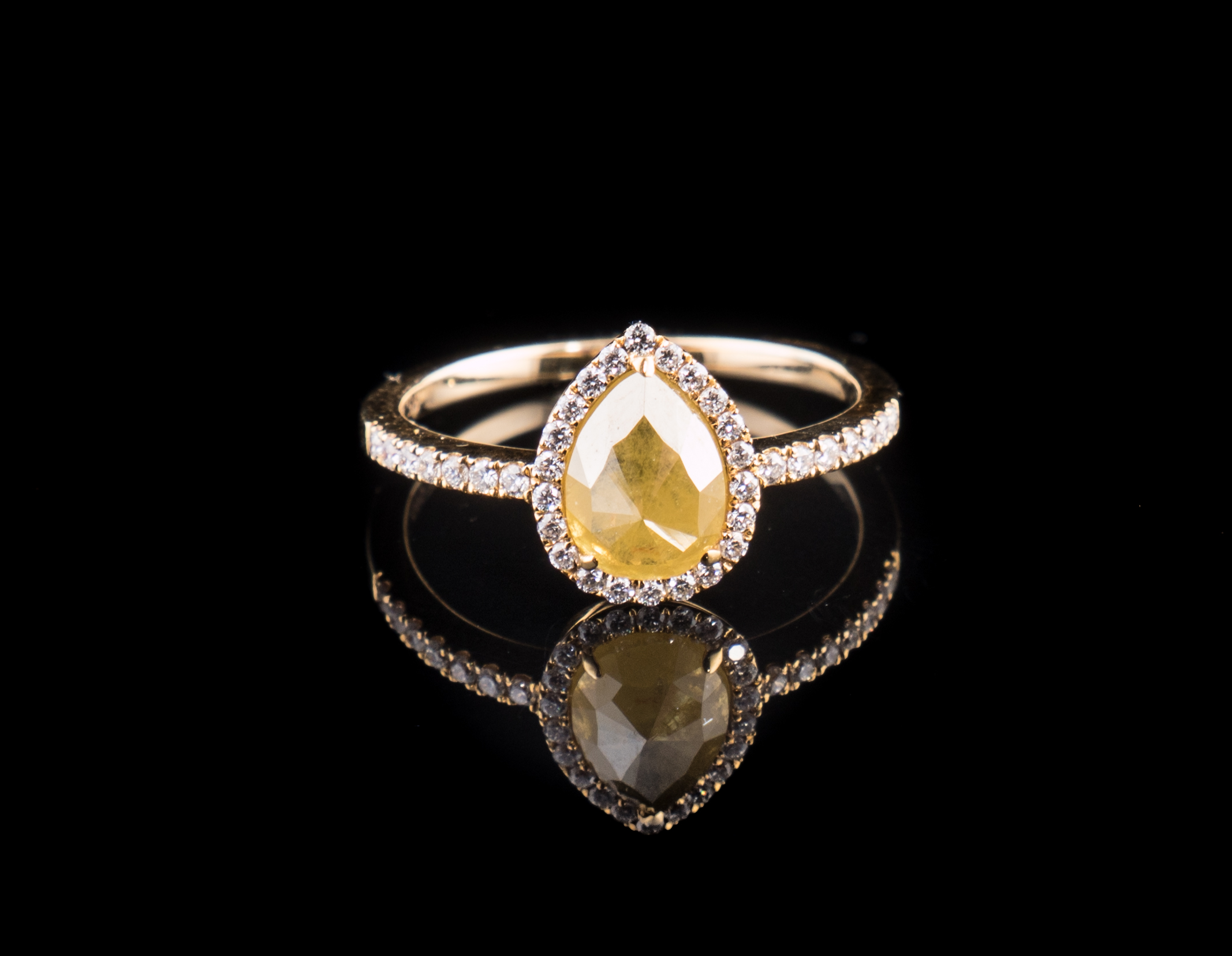 pear shape 14kt yellow gold diamond halo ring with one natural color, rough cut center Diamond.jpg