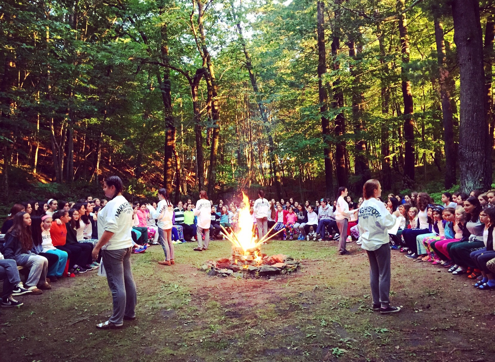 "Soopers lead ""Circle Game"" at the girls' opening campfire."