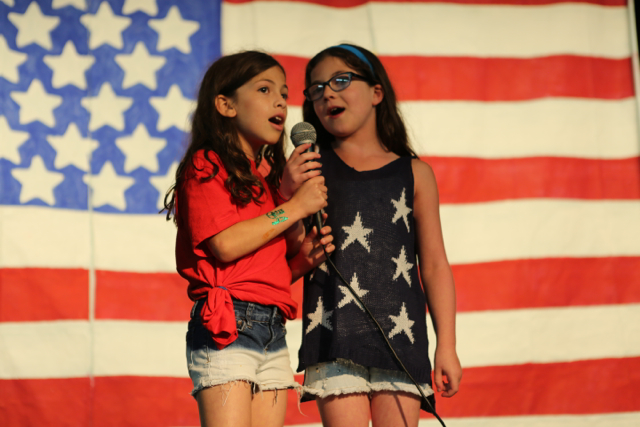 """Two Jinters sing """"Tomorrow"""" (from Annie) during the 4th of July Talent show."""
