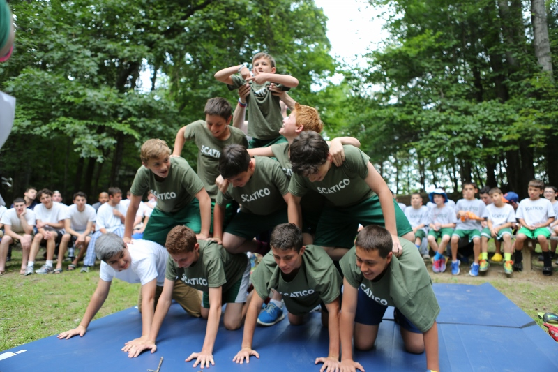 Timed human pyramids at the College Bowl campfire.