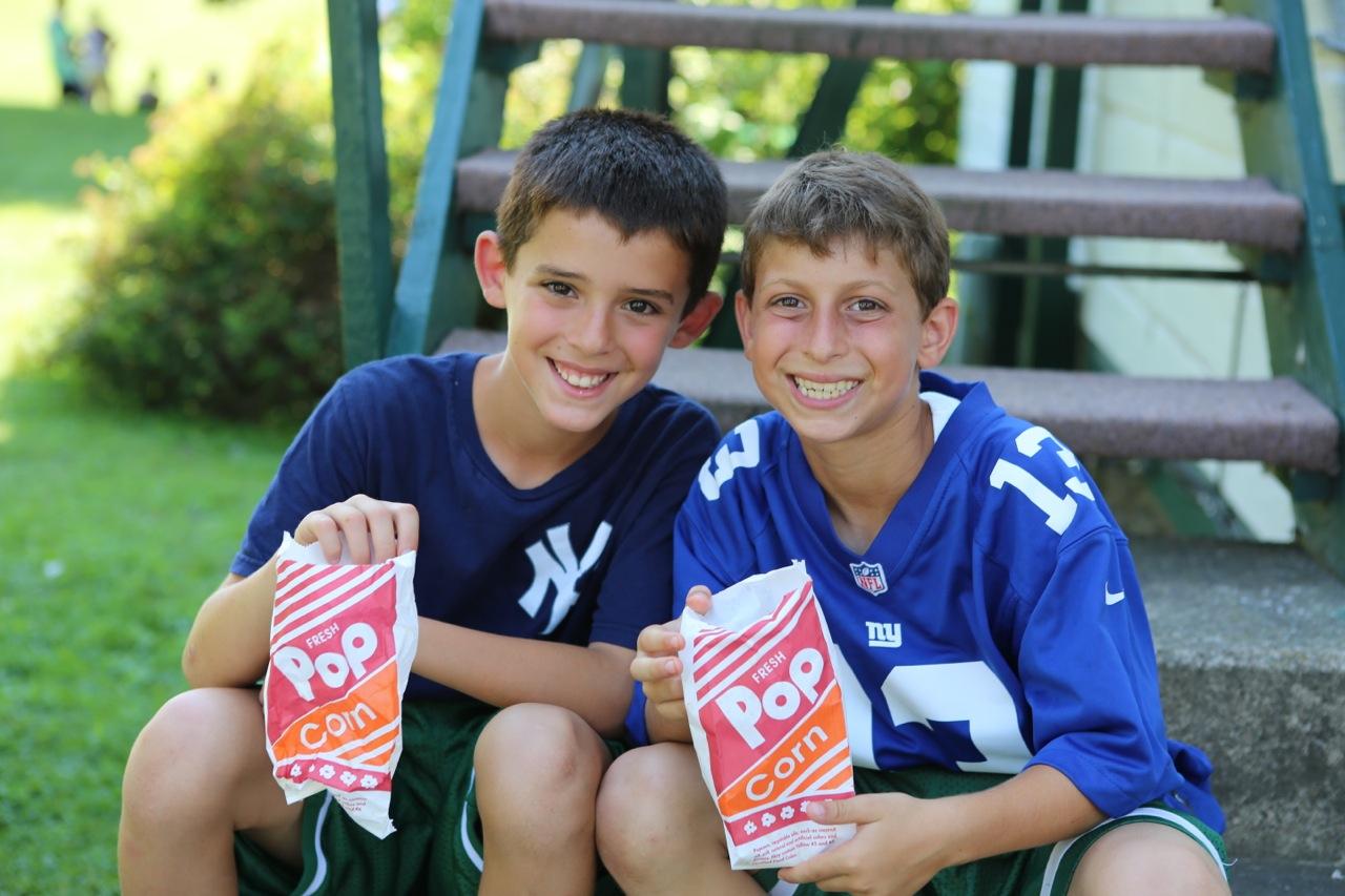 Sub Junior boys enjoy popcorn.