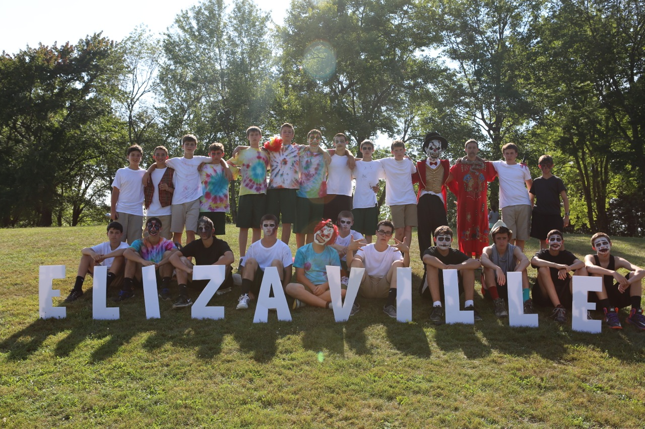 Upper Seniors pose with our Elizaville sign.
