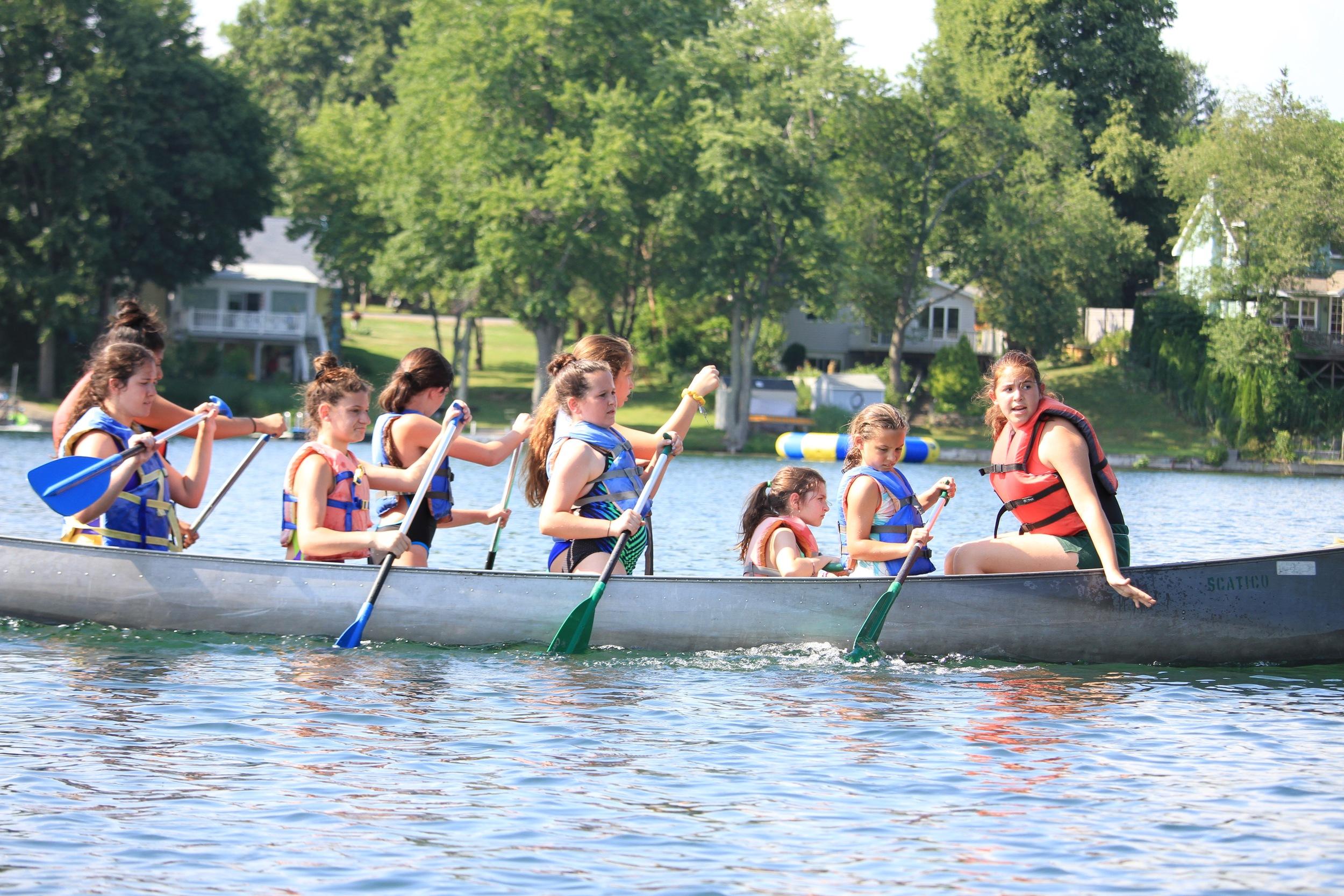 Sooper Anna Rosenfeld leads a all-division War Canoe during the Tribes' Swim Meet
