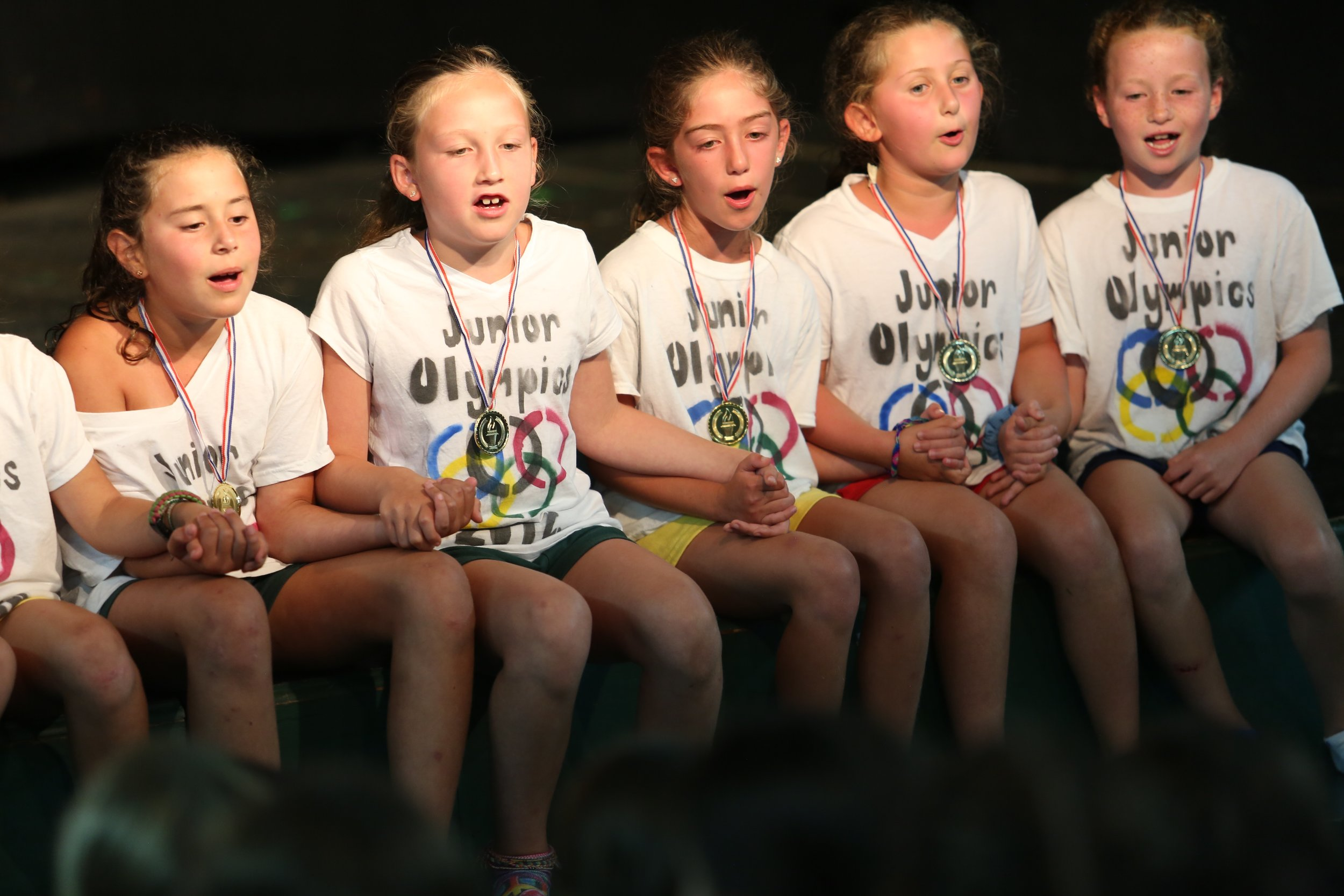 The Junior girls during Divisional Sing.