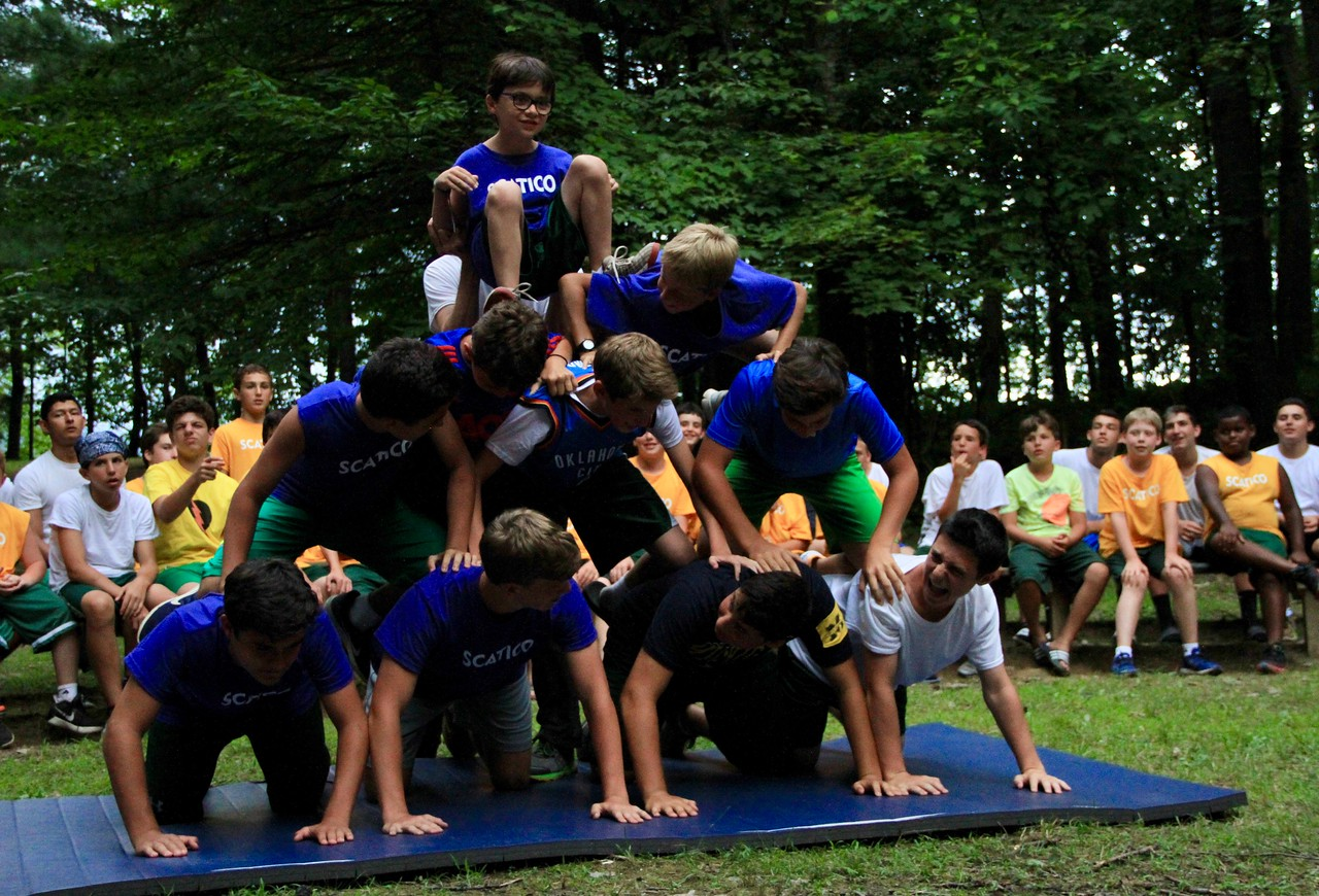 Campers put their strength to the test in a human pyramid