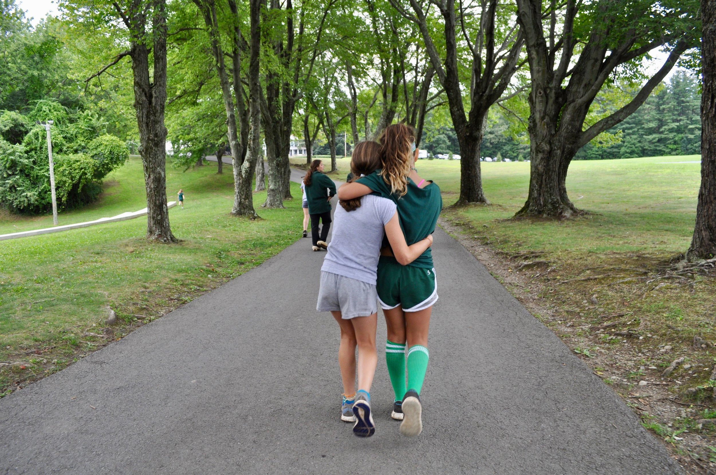 Campers take a time out on the team rivalry to display their friendship