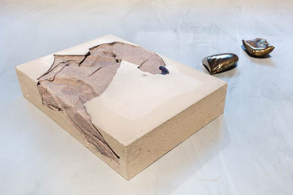Marie Lund: 'Torso', 2014, concrete and textile, and 'Hand Full', 2014, bronze // Photo by Berlin Art Link