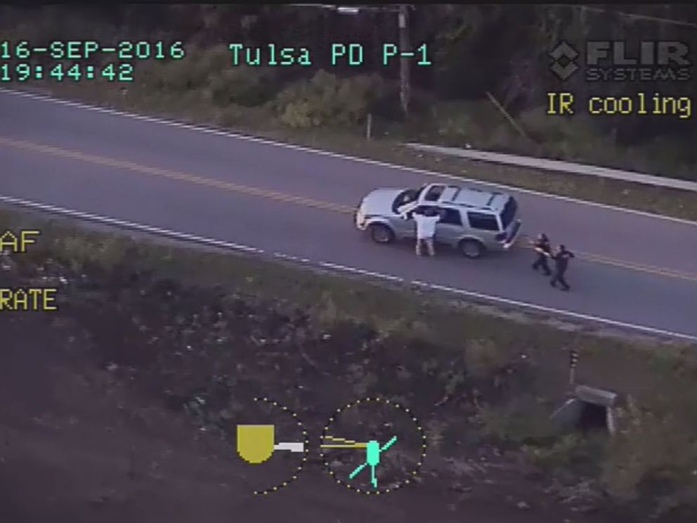 Credit: image released by the Tulsa Police Department, shows Crutcher with his hands raised moments before Shelby opens fire.