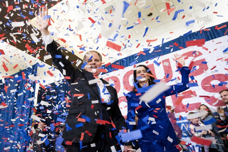 Reminiscent of the 2016 Democratic convention, the confetti streamed endlessly as former prosecutor Doug Jones celebrated the moment hand-in-hand with his wife.  Credit: Bill Clark / CQ Roll Call via Getty