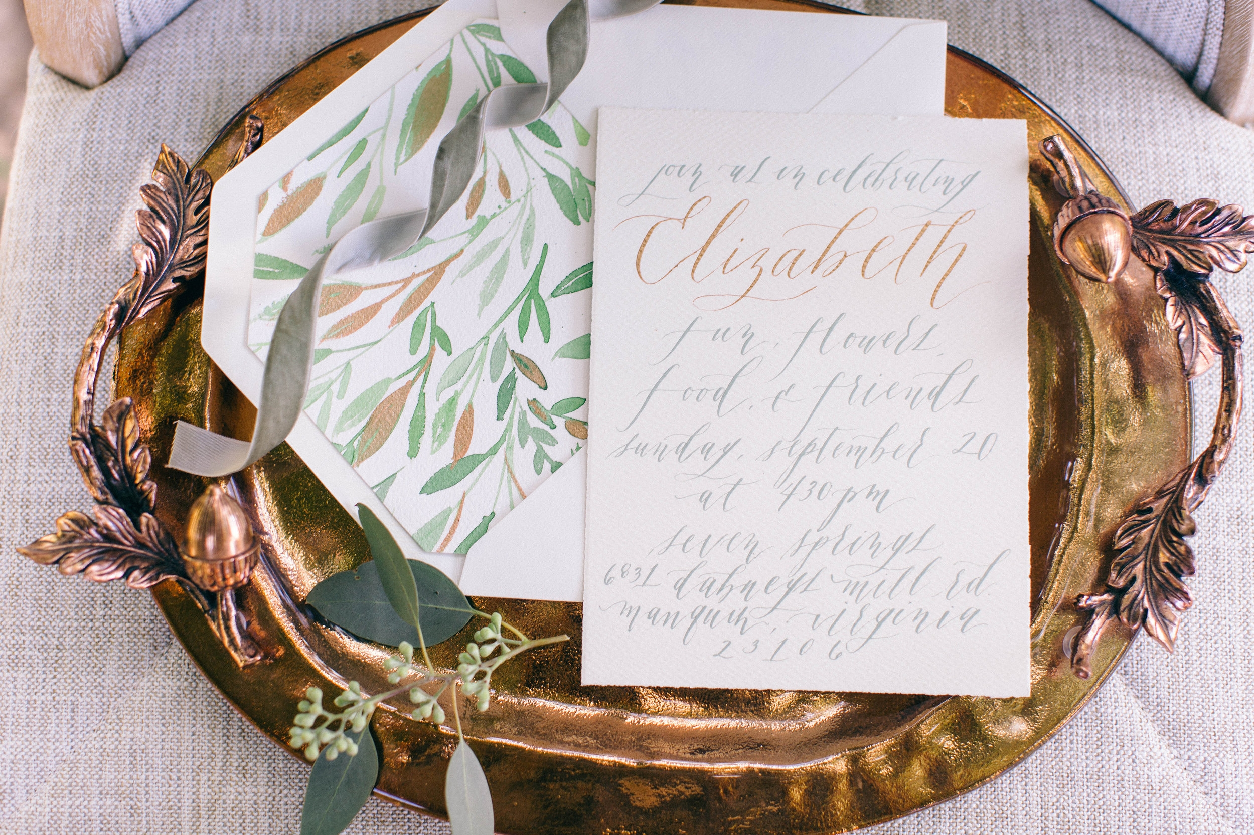Invitation suite display on a tray.