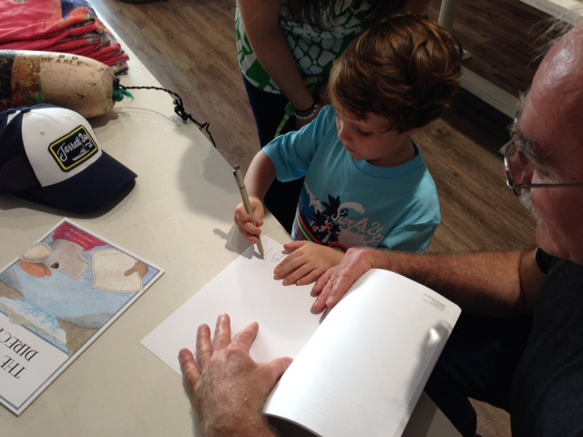 Beckett autographing my copy