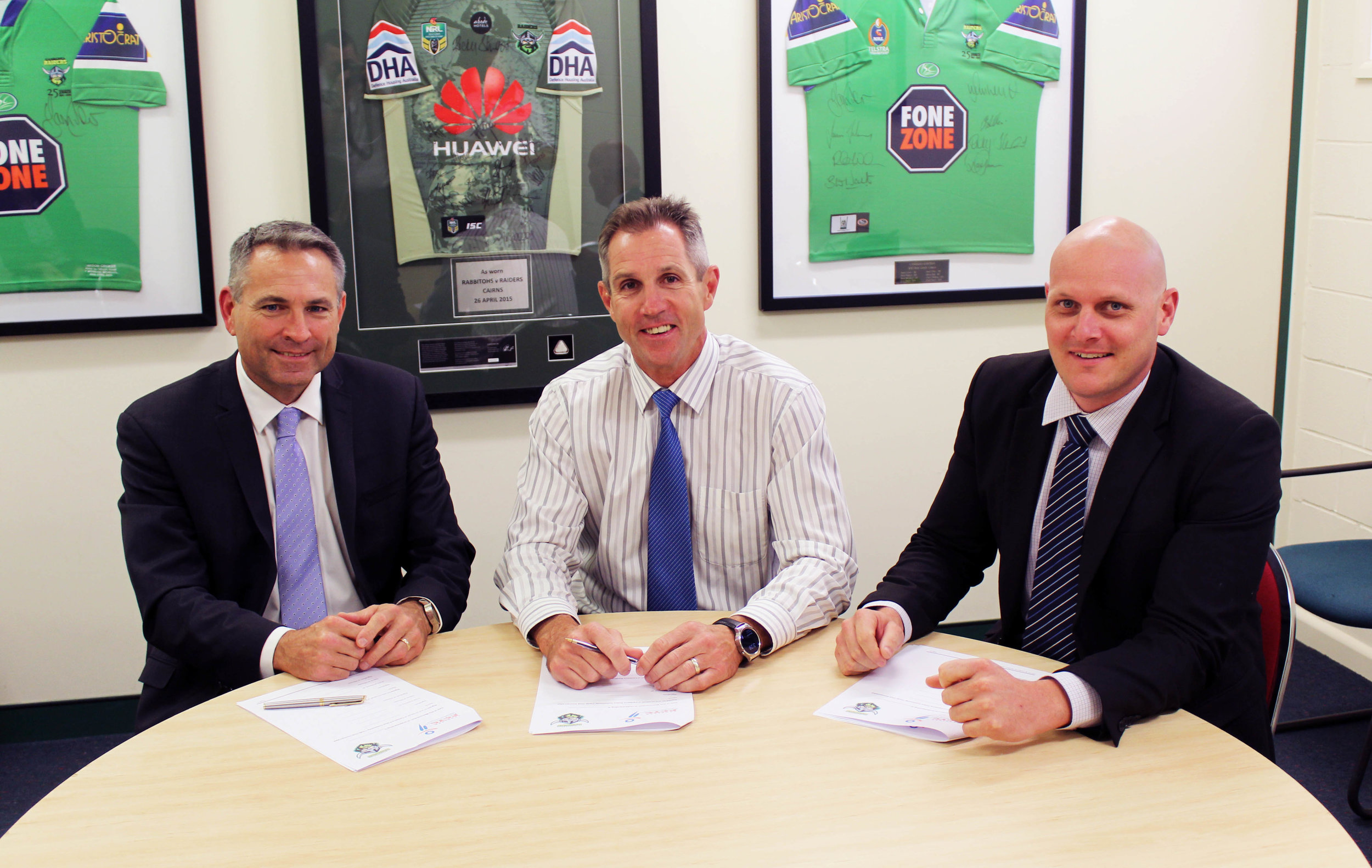 Canberra PCYC President David McLean, Raiders CEO Don Furner and Canberra PCYC General Manager Stephen Imrie formally sign the MOU between the Canberra PCYC and Canberra Raiders on Thursday at Raiders HQ