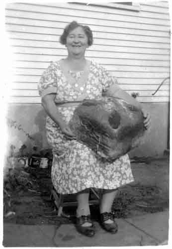 For a period of time, a 4th Class was included in this signature event. Individuals would bake and enter a Kolacky in the Largest Kolacky Class. Above is Mrs. Trcka with her own Glorified Bohemian Bun from the 1940s.
