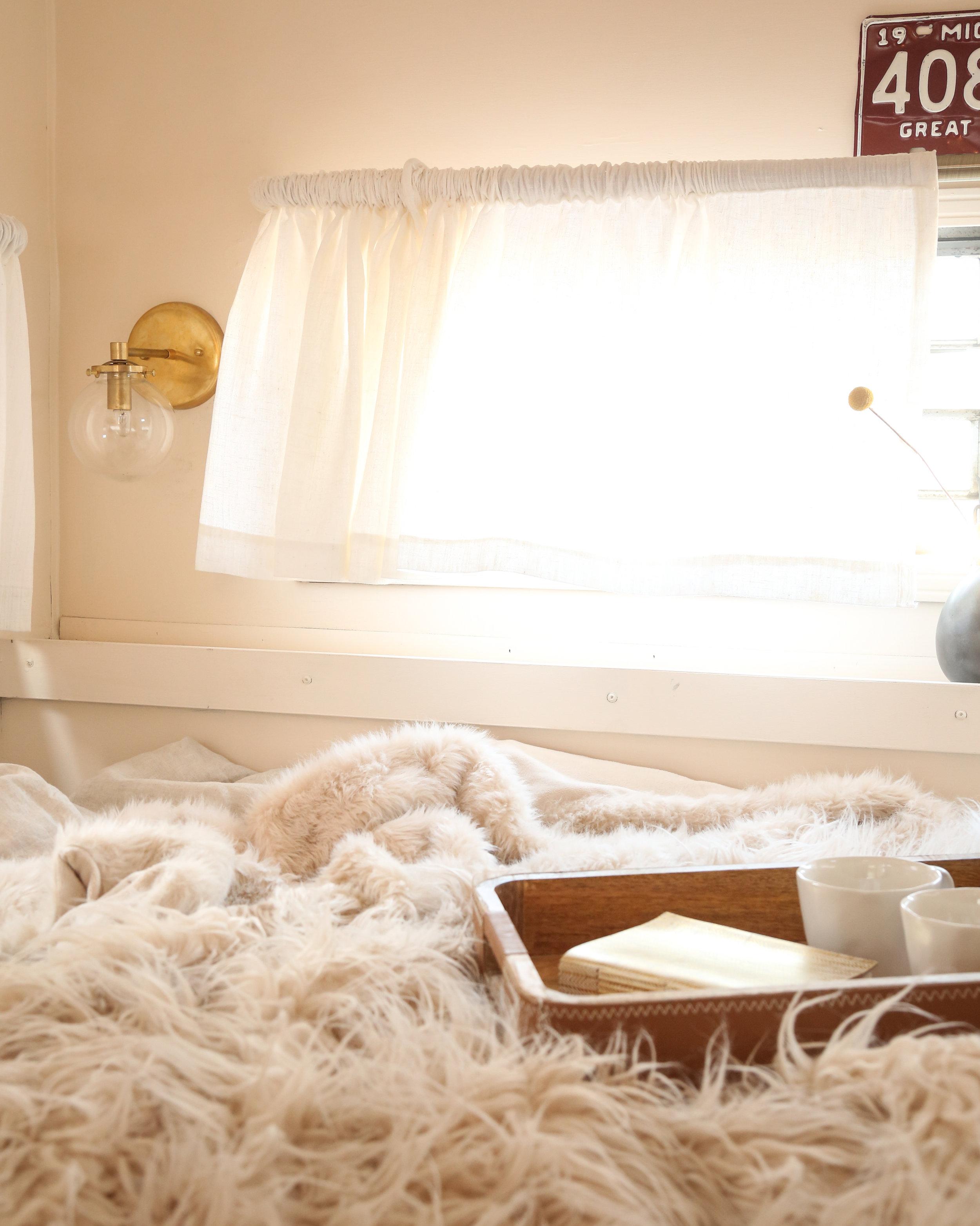 renovated vintage camper bedroom
