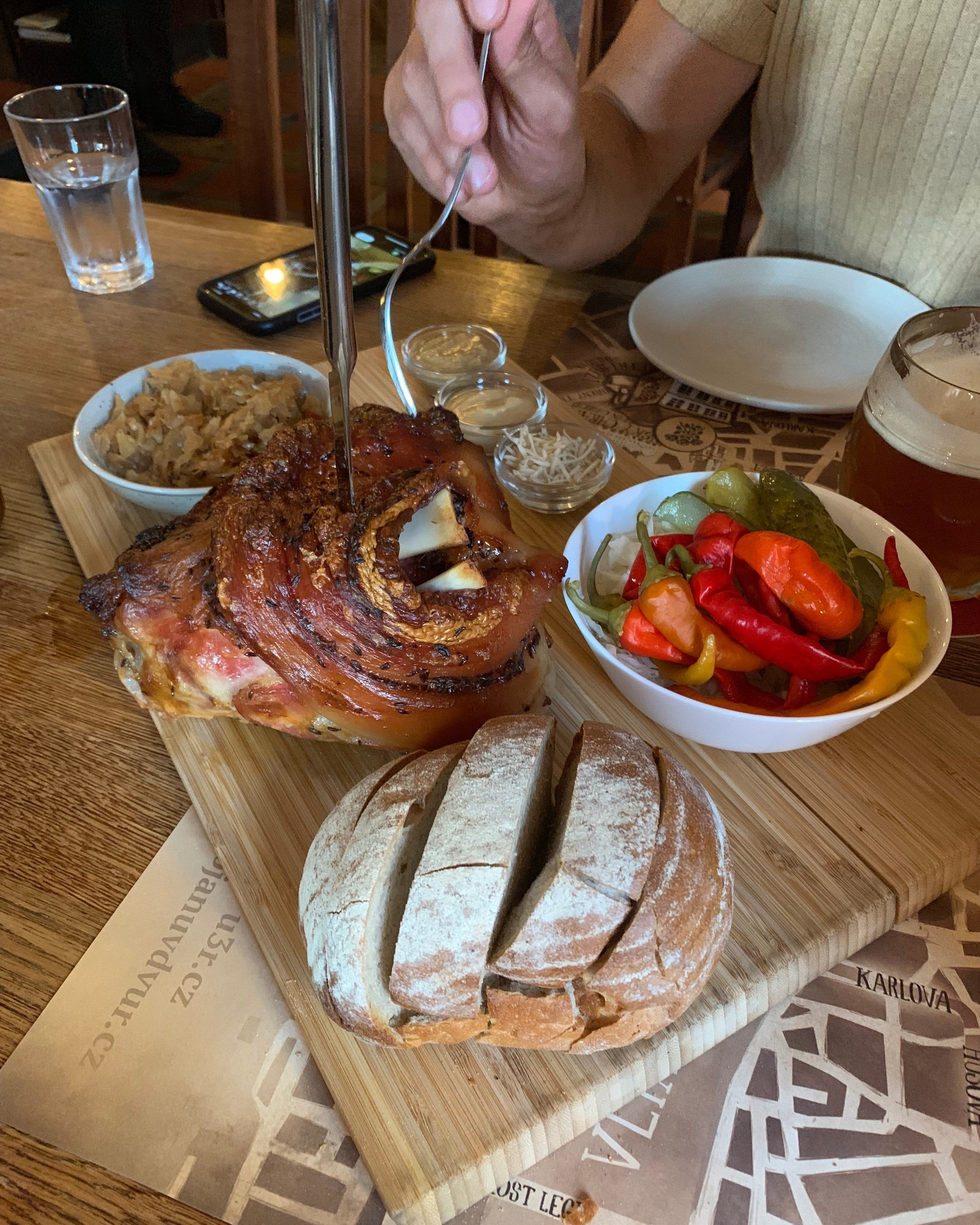 roasted pork knuckle with cabbage and bread and fixings!