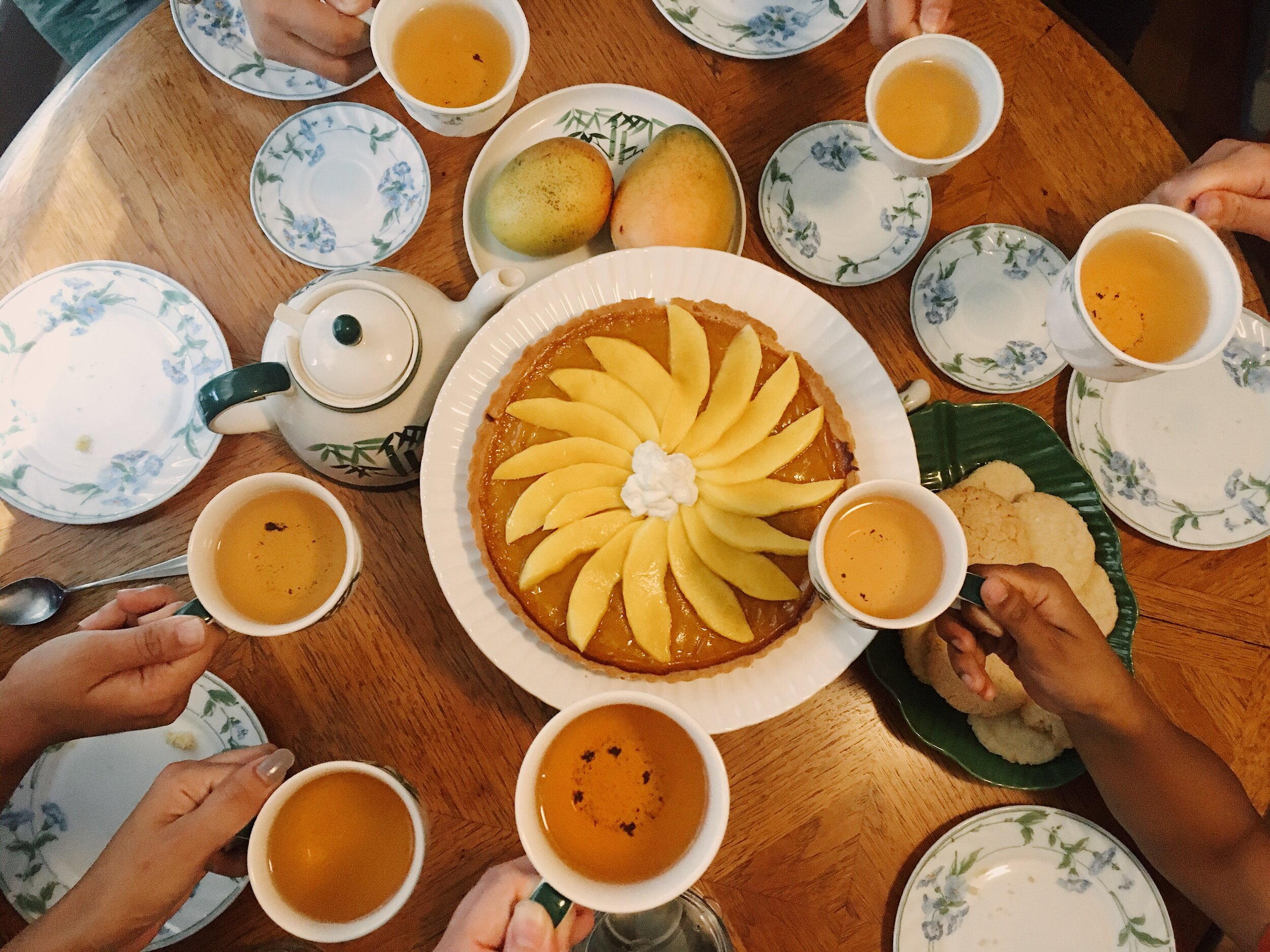 I had a few friends over for teatime the other day! We baked chewy coconut-lime sugar cookies and a magnificent mango passionfruit tart.