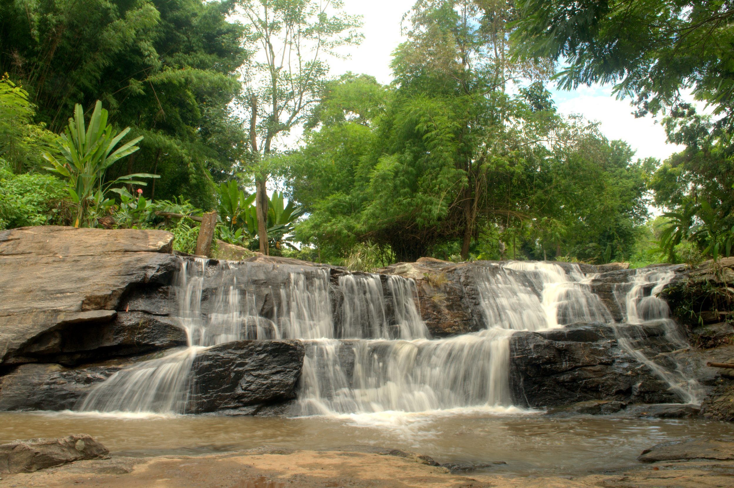 Take time to listen and enjoy the view like this gorgeous waterfall on the edge of a national park in Northern Thailand!