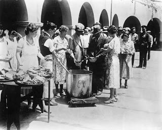 Great Depression era bread and soup line. The image is possible from The Library of Congress archives