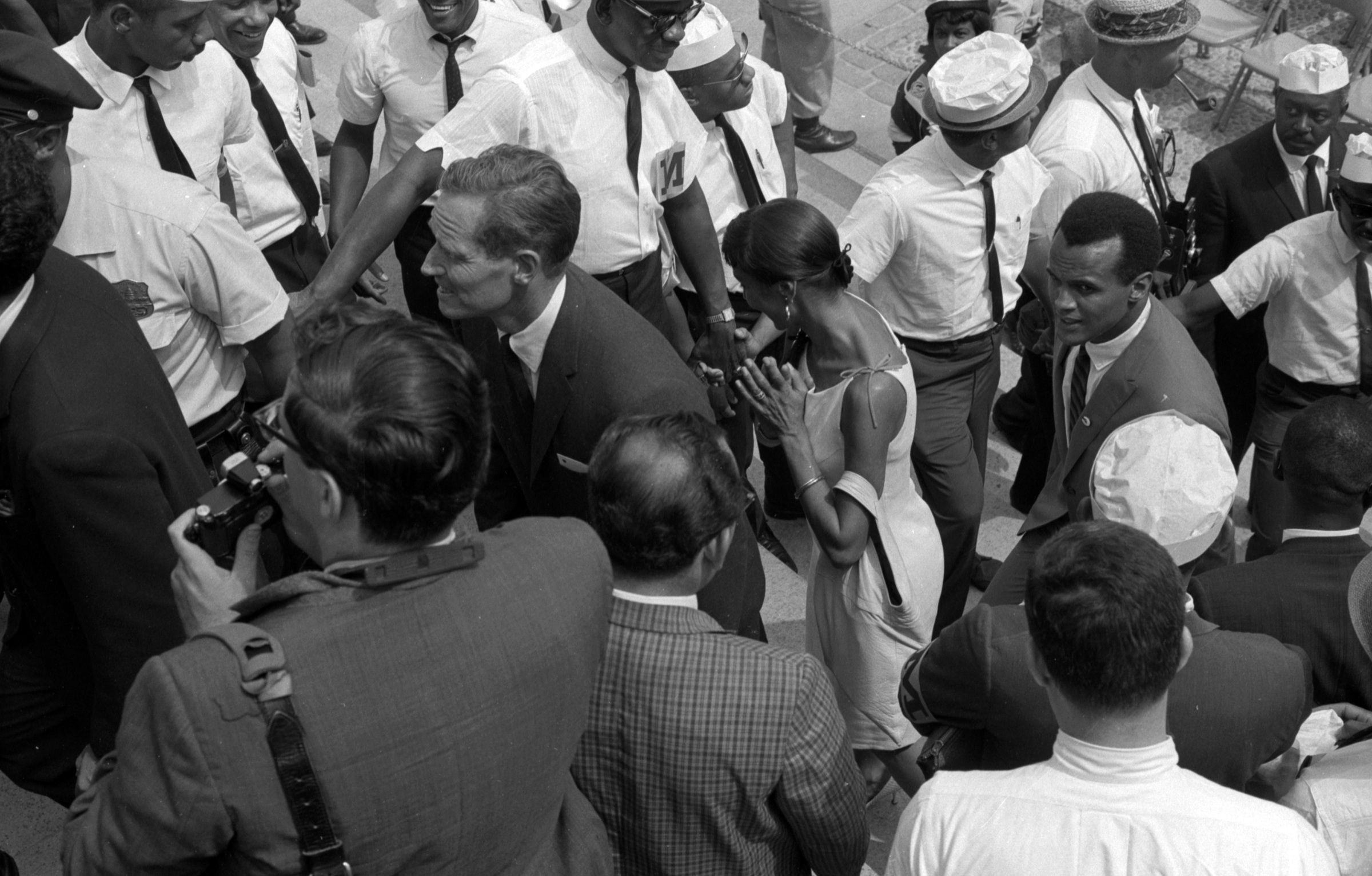 Actor Charlton Heston followed by Harry Belafonte at the rear of the Lincoln Memorial on the day of the March on Washington, Courtesy of the library of Congress