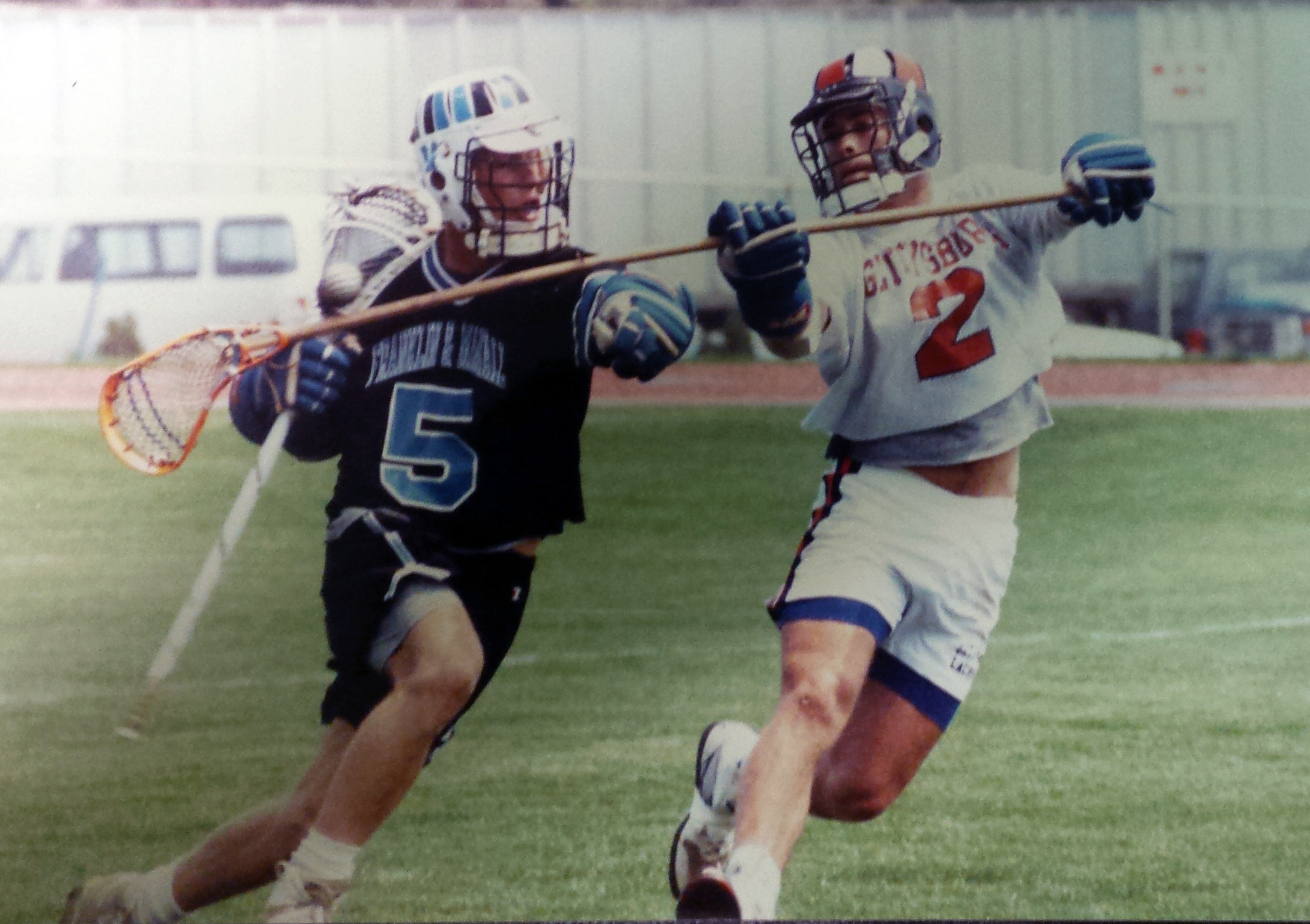 Gettysburg College All-American defenseman Bill Stedman (2 white) covering Franklin and Marshall attackman and Hunter Fogg (5 blue) in 1991.