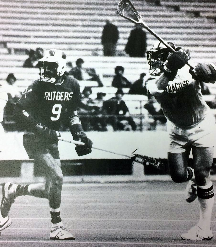 Greg Tarbell, right, taking a shot against Rutgers University in the carrier Dome. Courtesy of Syracuse University.
