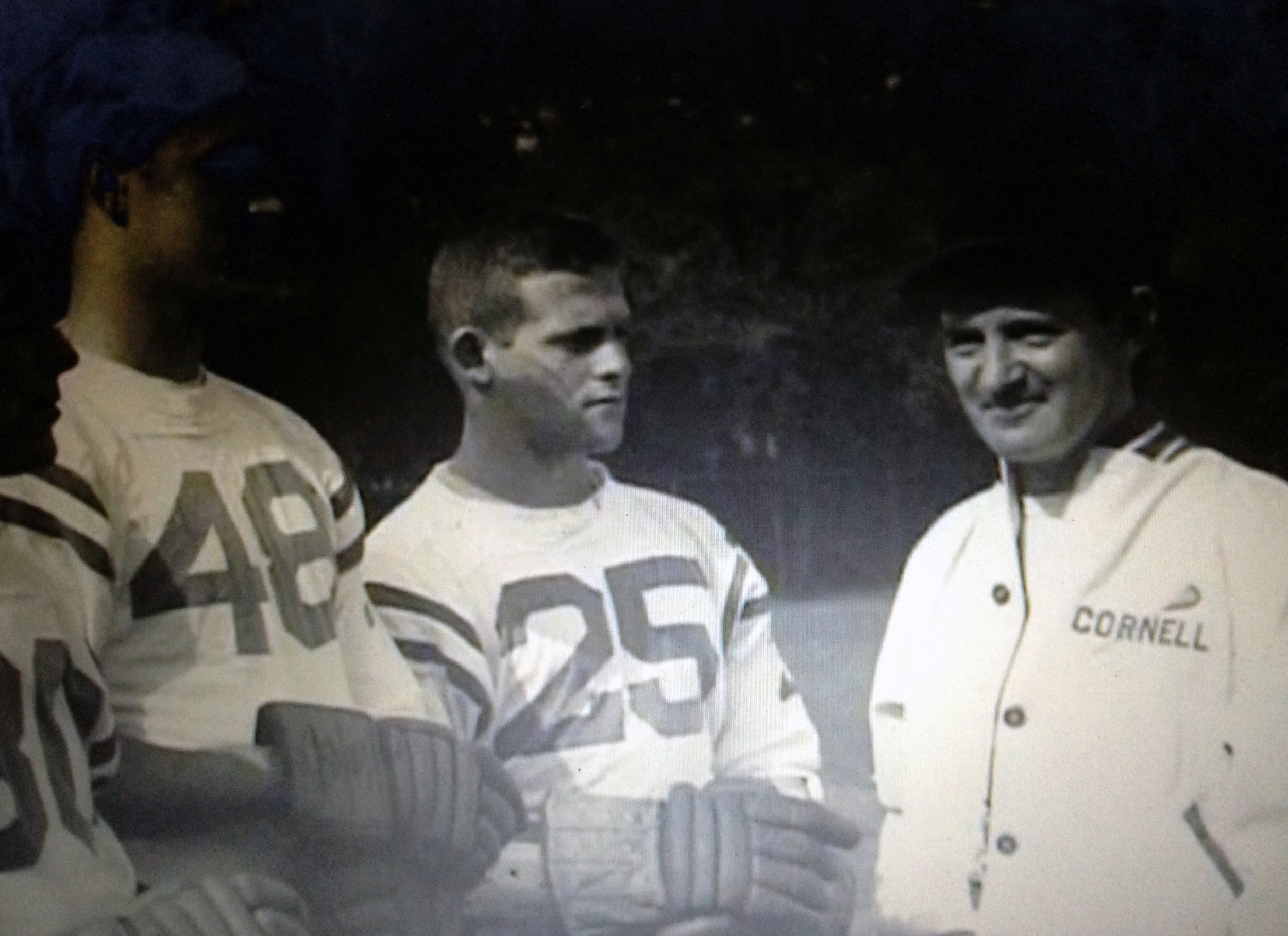 Bruce Cohen wearing 25 next to Cornell Coach Ned Harkness, Courtesy of Bruce Cohen