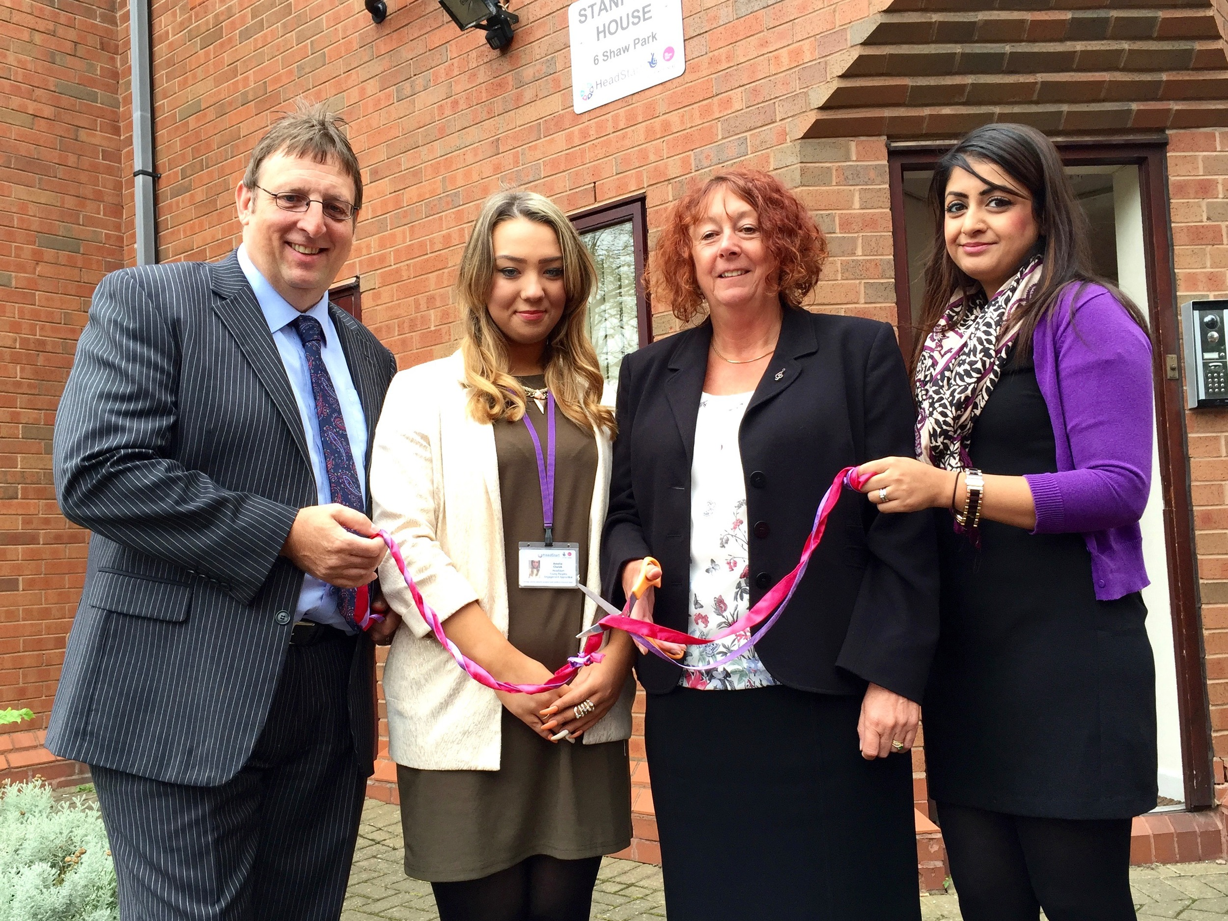 Councillor Val Gibson cutting the ribbon at the new offices, alongside Kevin, Sunita, and HeadStart Apprentice,Amelia.