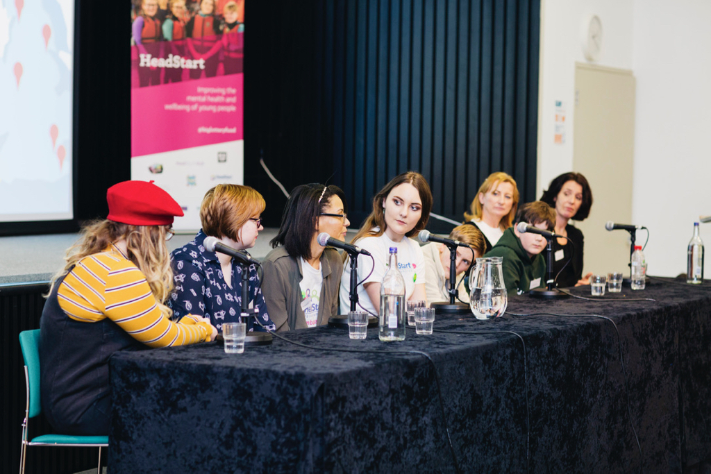 The young person discussion panel, including Cristina and Hannah (centre)