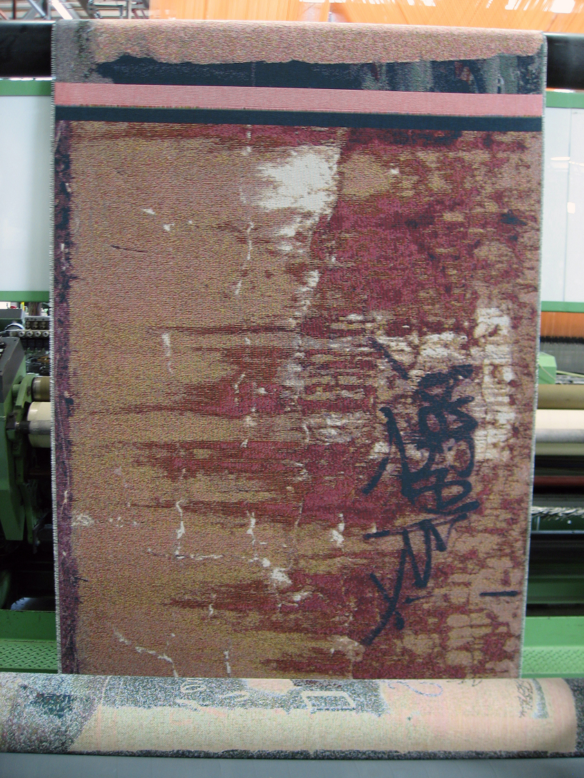 "Another Jacquard tapestry, entitled ""Layers,"" with the weaving moving over the big rollers at the back of the loom."