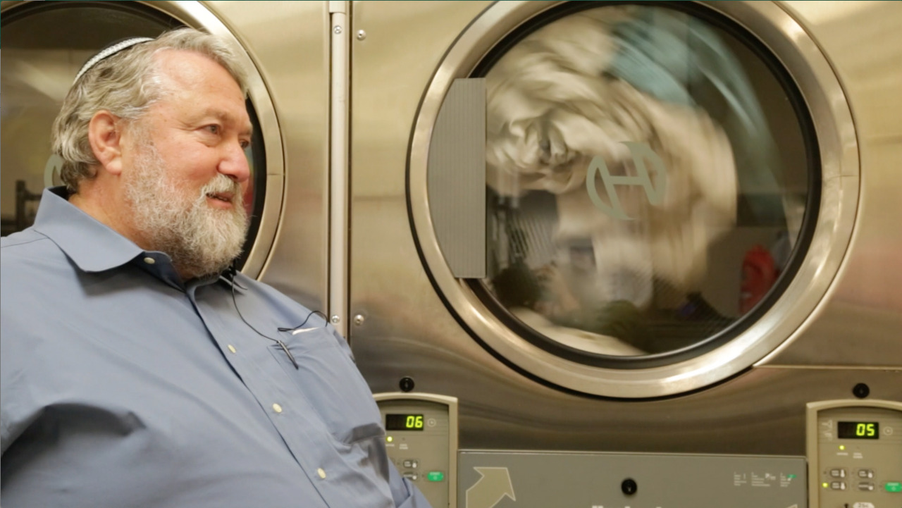Mendy Erez telling the story of the laundered soul at the laundromat that was once his synagogue.