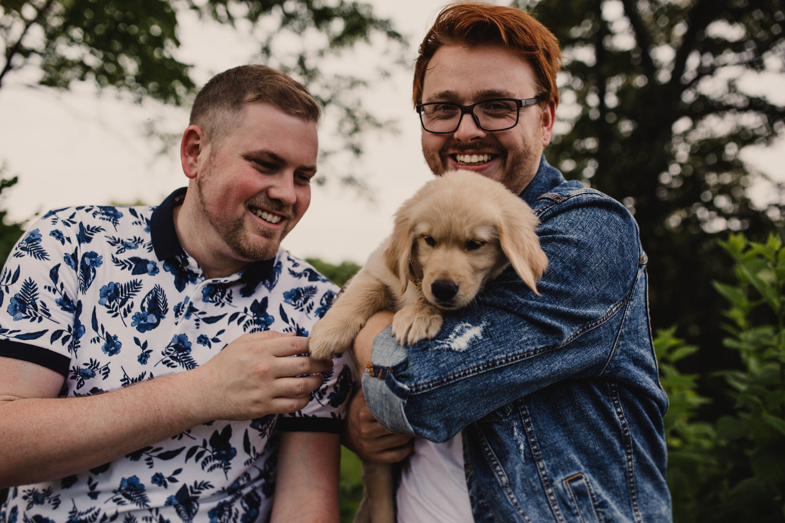 Engagement portrait of same sex couple with new puppy in West Virginia.